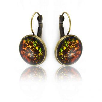 http://www.bijouxdecamille.com/14907-thickbox/boucles-d-oreilles-glitter-dragonne-en-metal-dore-vieilli-et-cabochon-a-reflets.jpg