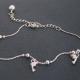 """Bracelet de cheville """"Dauphins"""" en métal argenté"""