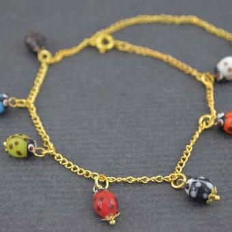 http://www.bijouxdecamille.com/5605-thickbox/bracelet-de-cheville-cox-en-metal-dore-et-resine.jpg