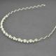 """Serre-tête """"Entrelats"""" en métal argenté, strass et perles de synthèse blanches"""