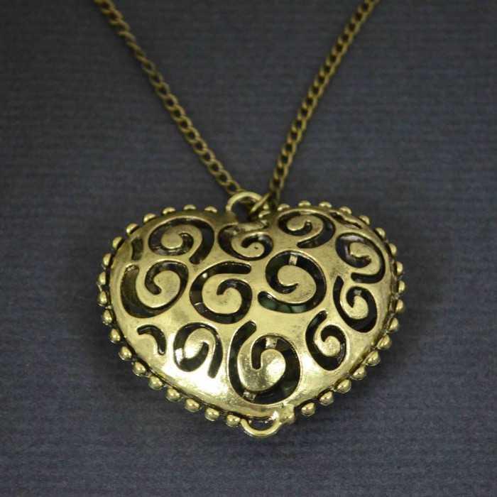"""Collier """"Tourbillon d'amour"""" en métal doré"""